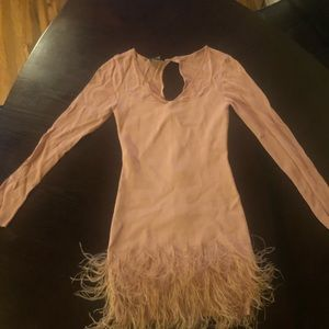 Plush Pink BeBe dress with feathers